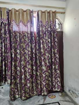 Curtains of 2 different designs
