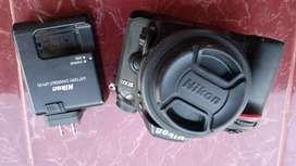 Kamera Nikon D 7100 + Lensa 35mm. 1.8G