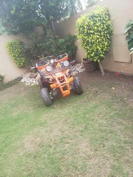 125cc quadbike with after market exhaust