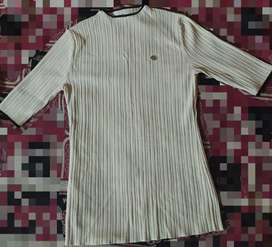 Top, size=small cream colour with black line on opens