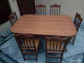 Dining Table (wooden) with 6 chairs.