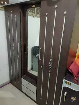 Four year old three door folding wardrobe in very good condition