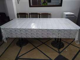 8 seater dining table with solid wood chairs.