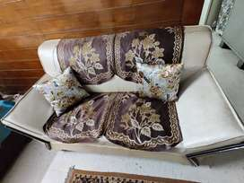 5 seater sofa set with a table