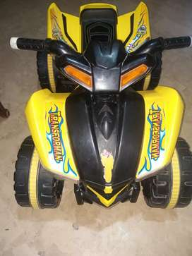 Kids battery operated four wheeler