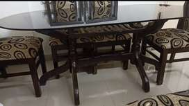 6 seater teak wood dining table with chairs-glass is cracked