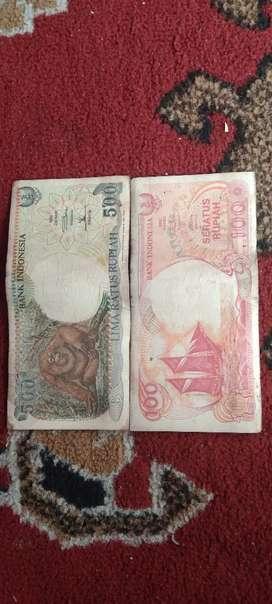 Uang 500 rupiah dan 100 rupiah