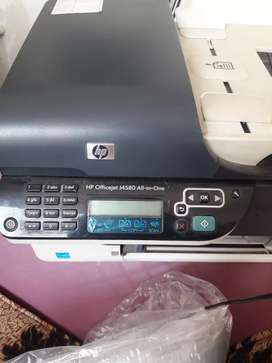 ALL-IN-ONE, printer, coloured copier, fax, scanner.  HP office J4580.
