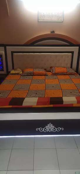 King size bad with storg and with said table led light