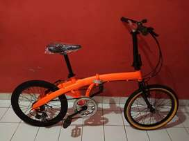 Sepeda lipat seli ukuran 20 stabilo orange dop
