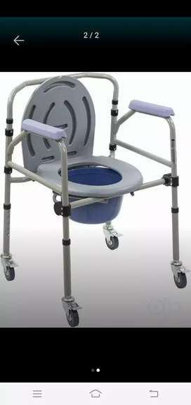 Folding wheel chair for patients