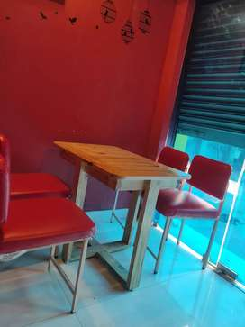 Chairs and pine wood tables for restaurant purpose