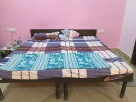 Double sized wooden bed
