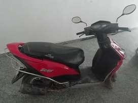 Red Honda Dio scooty 2013 model