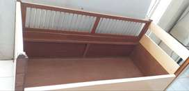 Bed with railing